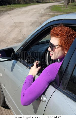 Woman driving her new car