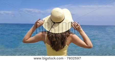 Woman standing on a shoreline at the beach