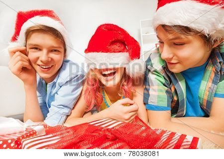 Fun for teens on New year party with Santa hats