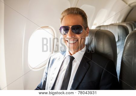 Businessman In Airplane.