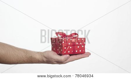 man holding red gift box in his palm