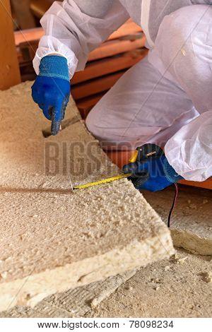 Man Laying Thermal Insulation Layer - Closeup