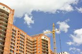 Building with elevating crane in horizontal composition poster