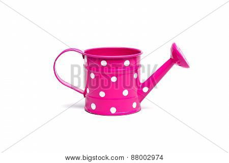 pink watering can with white spot isolated