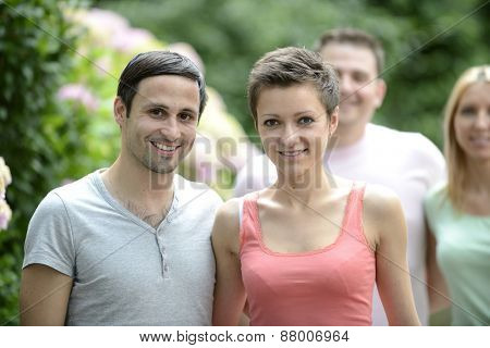 Portrait of a happy young heterosexual couple looking at camera