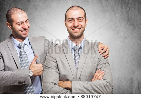 Smiling businessman congratulating with himself poster