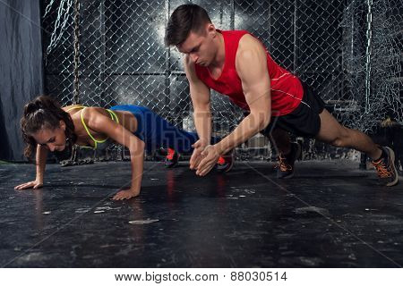 Sportsmen. fit male trainer man and woman doing clapping push-ups explosive strength training concep