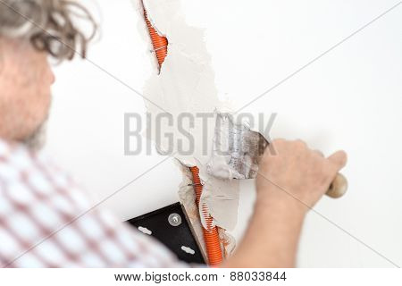 Electrician Plastering Recessed Wiring In A Wall