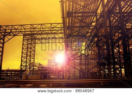 metal structure of industry chemical tube in heavy industrial estate against beautiful sun rising with lens flare effect use for industry background poster