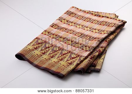 Malaysia Songket .Songket is a fabric that belongs to the brocade family of textiles of Indonesia, Malaysia and Brunei. It is hand-woven in silk or cotton poster