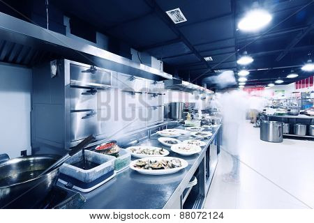 modern kitchen and chefs in hotel