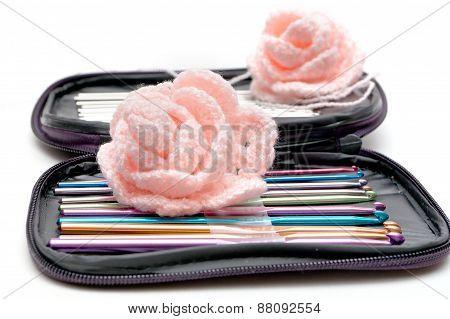Set of varicoloured hooks for knitting and flower poster