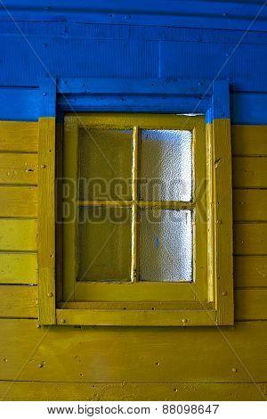 Old Yellow Window In Blue Wall