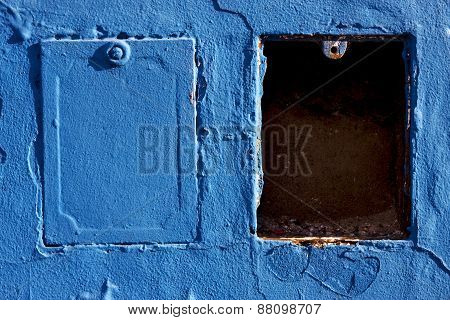 Two Metal Box And A Blue Wa