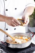 Chef putting Japanese curry paste for cooking / cooking Japanese pork curry paste concept poster