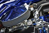 Blue and Chrome 1967 car engine with a 427 engine. poster