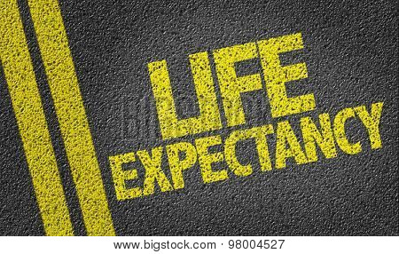 Life Expectancy written on the road poster