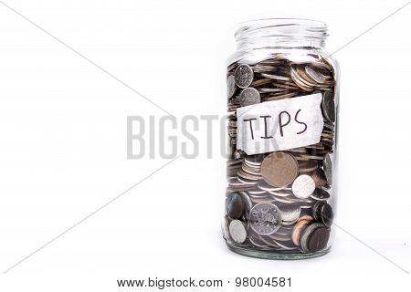 A glass jar with the label Tips full of loose change poster