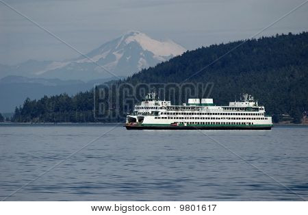 Ferry With Mt. Baker On A Background