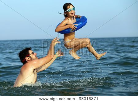 Daddy Plays With Her Daughter By Making Her Do High Dives In Seawater