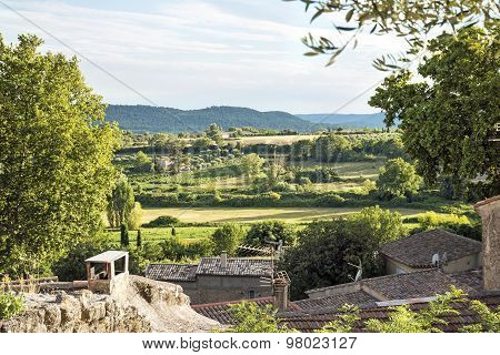 View Over The Roofs Of An Old Village In The Landscape Of Provence