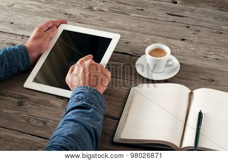 The Men Hand Presses The Blank Screen Tablet Computer