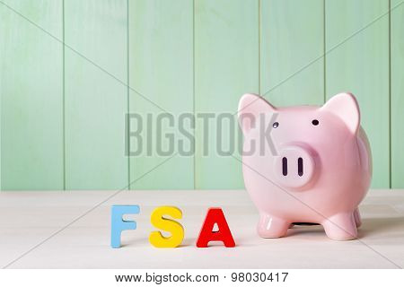 Fsa Theme With Wood Block Letters And A Piggy Bank
