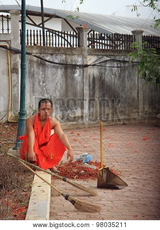 buddist monk is resting after the street cleaning
