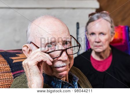 Concerned Elderly Couple
