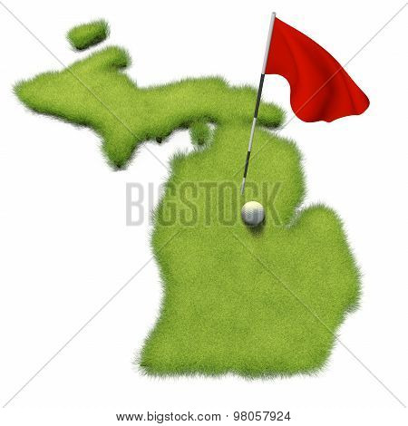 Golf ball and flag pole on course putting green shaped like the state of Michigan