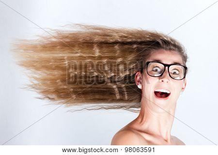 Long hair of woman blowing in head wind
