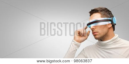 people, technology, future and progress - man with futuristic 3d glasses over gray background