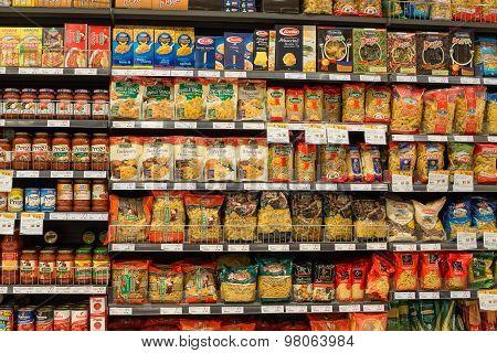 Selection of italian pasta on the shelves in a supermarket Siam Paragon Bangkok.