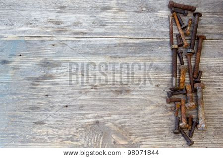 Old Bolts Or Dirty Bolts On Wooden Background, Machine Equipment In Industry Work. Copy Space To Rig