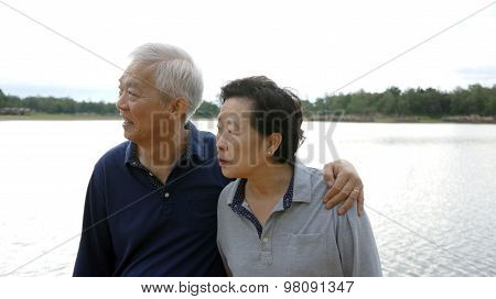 Asian Senior Couple Happy Hugging Together Lake Background