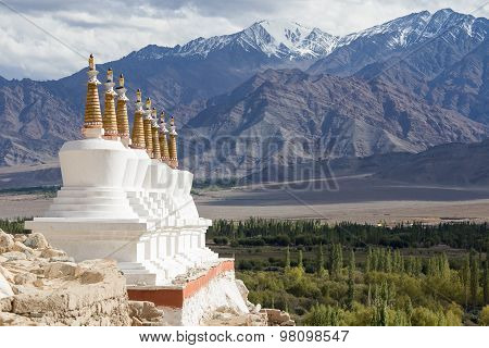 Buddhist Stupa And Himalayas Mountains . Shey Palace In Ladakh, India