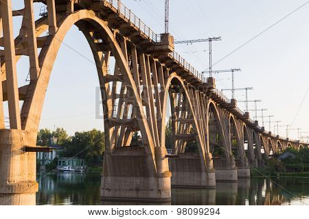 Old Curved  Railway Bridge Over River Dnieper . Dnepropetrovsk.
