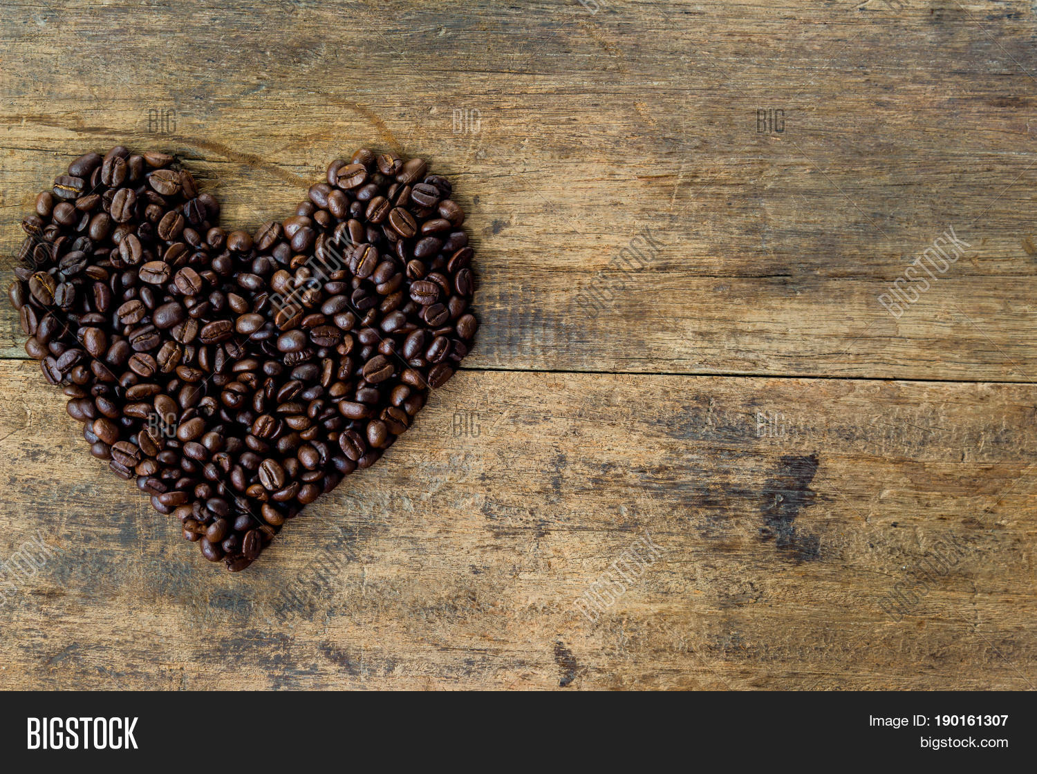 Lovely Heart Shape By Roasted Coffee Beans On Rustic Wood
