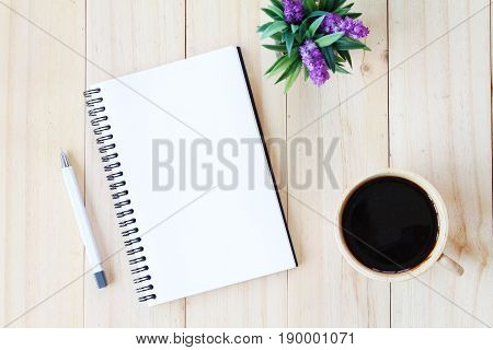 Still life, business, office supplies or education concept : Top view image of open notebook with blank pages and coffee cup on wooden background, ready for adding or mock up