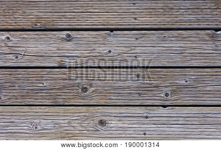 Close up of weathered wood on a boardwalk. Photographed in natural light.