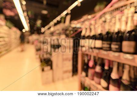 Blurred Wine Bottle On Shelf In Store