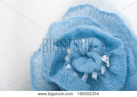 Knitting mohair wool and knitting needles for handmade on wooden table. Blue Flower