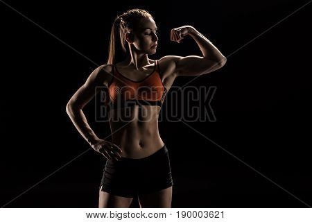 Confident Young Caucasian Athlete In Sportswear Flexing Biceps