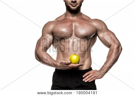 cropped view of shirtless muscular sportsman holding yellow apple isolated on white healthy eating concept