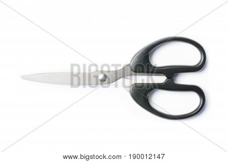silver scissors and black handle isolation on white background