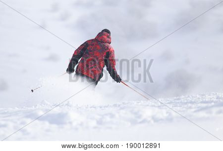 A Skier in high mountains . A photo