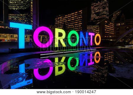 View of Toronto Sign on Nathan Phillips Square at night, in Toronto, Canada