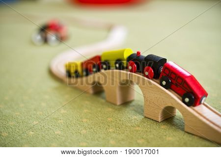 Wooden train toy on a bridge, toy for kid