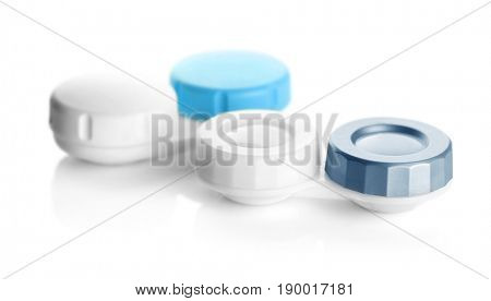 Containers for contact lenses on white background