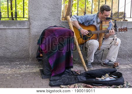 KIEV UKRAINE - June 04 2017. Street musician man playing the guitar outdoors